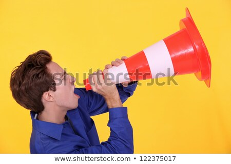Man shouting through traffic cone Stock photo © photography33