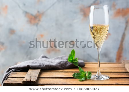 Sparkling wine on the table Stock photo © brebca