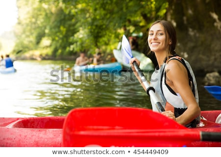 Brunette girl in canoe Stock photo © photography33