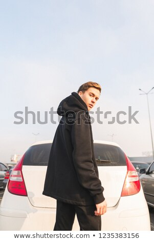 dinamikus · stílus · fotó · jóképű · fiatalember · város - stock fotó © konradbak