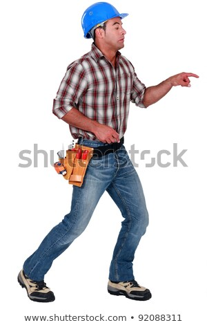 A male construction worker poking something scary. Stock photo © photography33