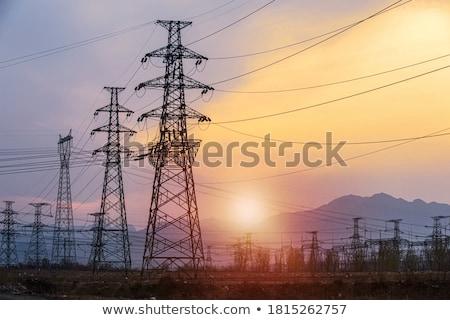 elektromos · narancs · égbolt · napfelkelte · felhők · fém - stock fotó © lunamarina