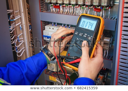 electrician working in electrical box stock photo © lisafx