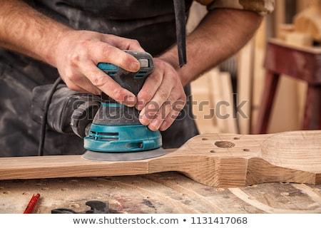 Carpenter holding electric sander Stock photo © photography33