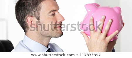 Businessman kissing a piggy bank Stock photo © photography33