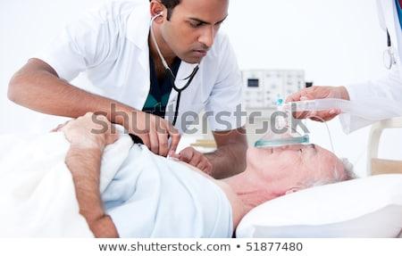 orvosok · oxigénmaszk · beteg · kórház · nő · nővér - stock fotó © wavebreak_media