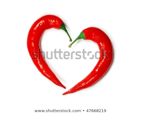 Stok fotoğraf: Two Chili Peppers Forming A Shape Of Heart Hot Lover Symbol