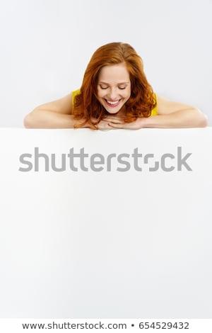 Donna guardando verso il basso felice sfondo Foto d'archivio © wavebreak_media