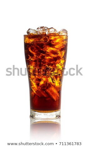 bottle of cola with glass full of soda and ice on white stock photo © escander81
