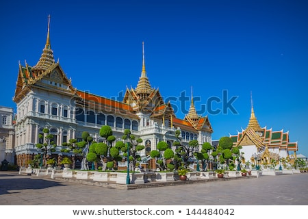 tiled roof of temple in the grand palace stock photo © meinzahn