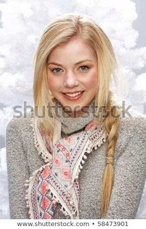 Fashionable Woman Wearing Knitwear And Cap In Studio In Front Of Stock photo © monkey_business
