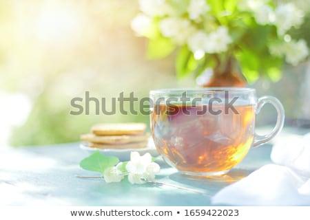 Csésze jázmin tea átlátszó cukor virágok Stock fotó © IngridsI