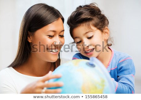 Pretty young schoolgirl in geography class Stock photo © stryjek