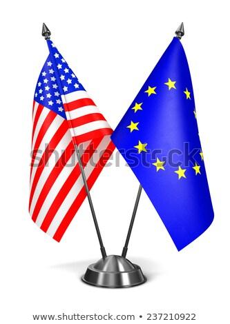 EU USA miniatűr zászlók izolált fehér Stock fotó © tashatuvango