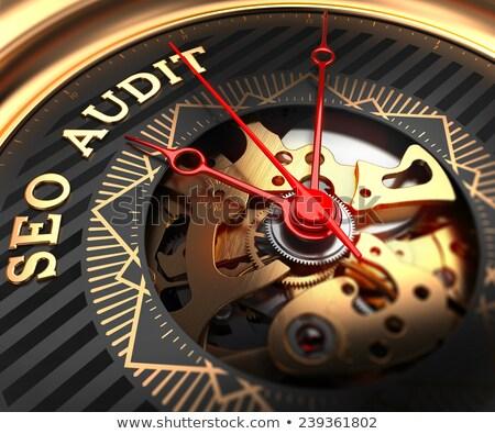 SEO Audit on Black-Golden Watch Face.  Stock photo © tashatuvango