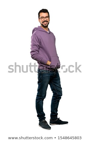 Full-length portrait of a happy man in glasses over white background Stock photo © deandrobot