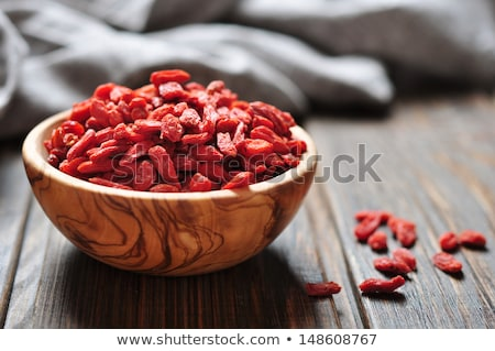 Heap of Dry Goji Berries on the Wooden Table Stock photo © maxpro
