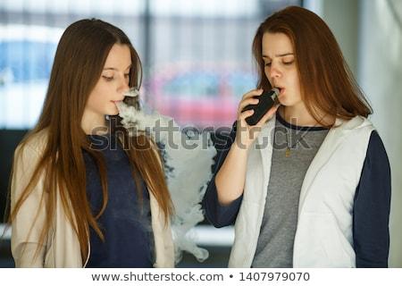 Due elettronica sigarette mentire giallo uno Foto d'archivio © JFJacobsz