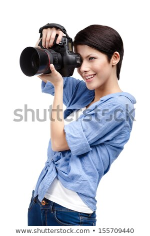 side view of a beautiful female photographer stock photo © wavebreak_media