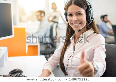 Beautiful young woman operator in headset Stock photo © deandrobot