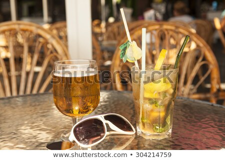 Misted Glass Of Mojito With Olives On A Glass Table Stock fotó © mcherevan