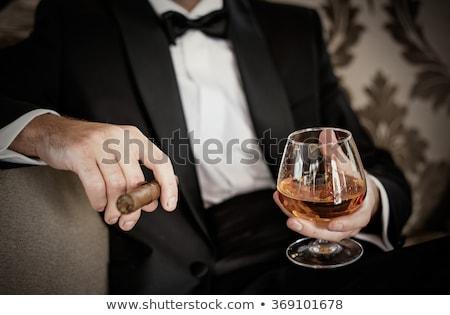 Divatos férfi szivar bőrdzseki dohányzás divat Stock fotó © stokkete
