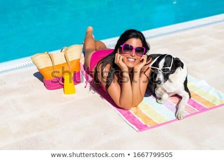 Sunbathes on poolside Stock photo © alphaspirit