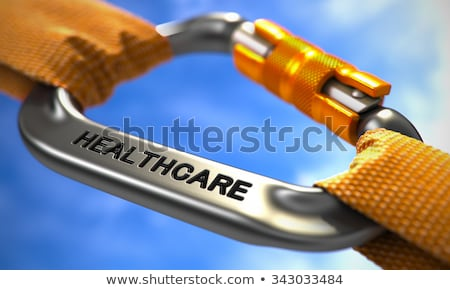 chrome carabiner with text health insurance stock photo © tashatuvango