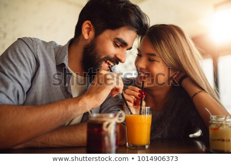 Couple Sharing a Drink Stock photo © lenm