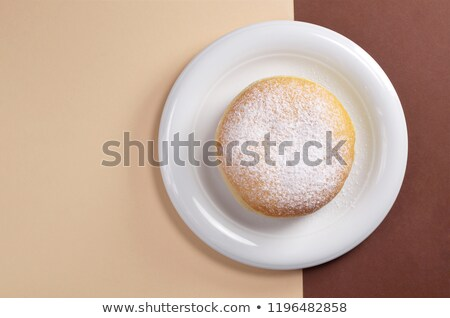 Top view of doughnuts with sweet topping on a plate Stock photo © stevanovicigor
