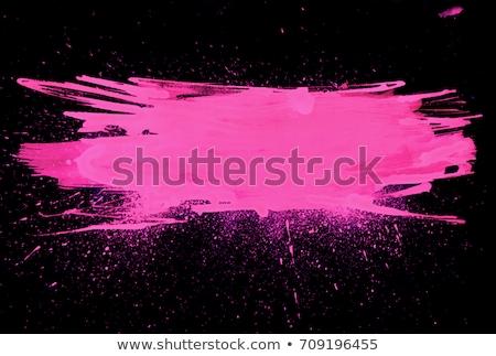 Pink lipstick with smear graphic stroke on black background Stock photo © adamfaheydesigns