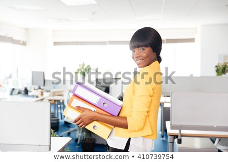 happy afro american businesswoman holding folders stock photo © deandrobot