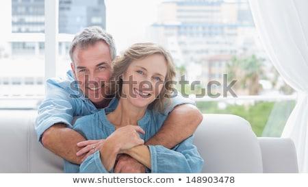 Człowiek uśmiechnięty relaks salon Zdjęcia stock © Giulio_Fornasar