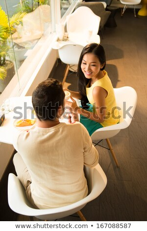 View from below of couple in cafe Stock photo © deandrobot