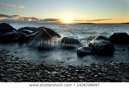 Reflected sunrise along shore of Lake Winnipeg Stock photo © pictureguy