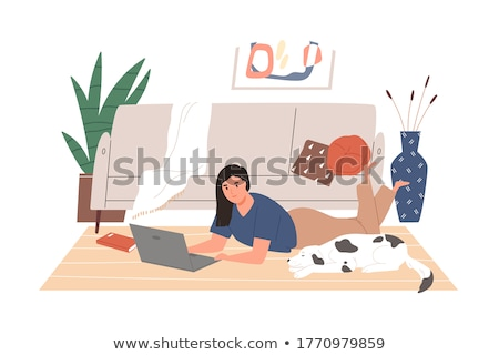 Dog lying in home office with woman in background stock photo © monkey_business