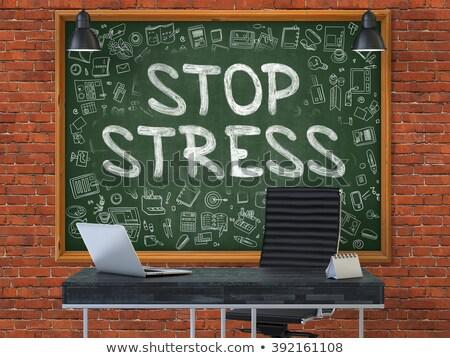 hand drawn stop stress on office chalkboard stock photo © tashatuvango