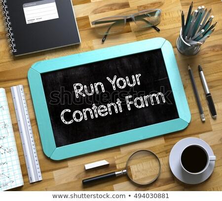 Run Your Content Farm Handwritten on Small Chalkboard. 3D. Stock photo © tashatuvango