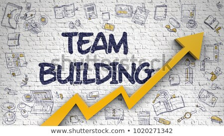 Team Building on White Brick Wall. Stock photo © tashatuvango