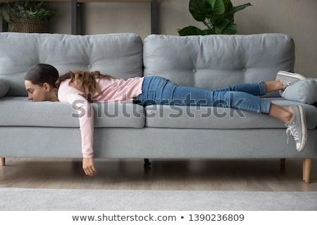 Jonge vrouw bank dutje vrouw woonkamer beker Stockfoto © monkey_business