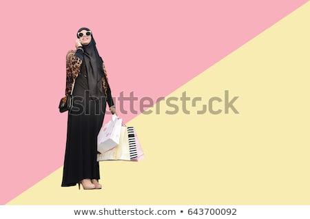 Muszlim nő hidzsáb bevásárlótáskák Dubai vásár Stock fotó © dolgachov