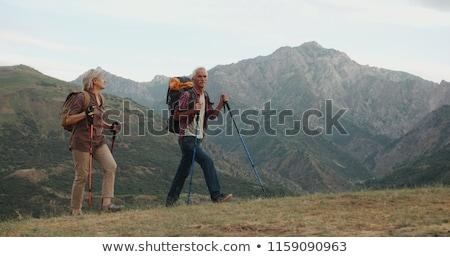 mosolyog · idős · férfi · sétál · kettő · mankók - stock fotó © is2