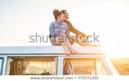 couple of travelers in retro minivan Stock photo © LightFieldStudios