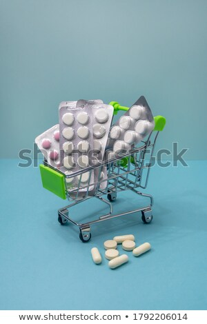 close up of a pack of blue pills stock photo © homydesign