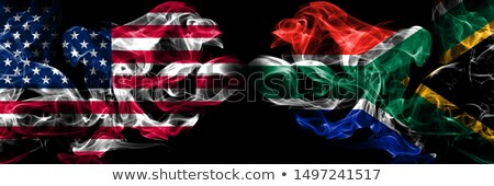 Football in flames with flag of south africa Stock photo © MikhailMishchenko