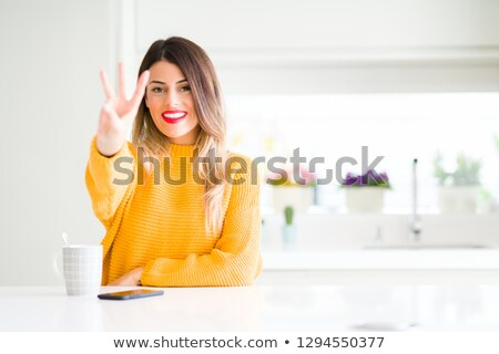 young girl holding up three fingers stock photo © is2