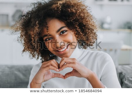 portrait of beautiful charming young woman with perfect skin hol stock photo © deandrobot