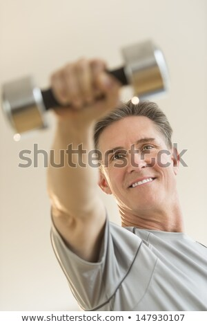 Low angle view of man lifting weights Stock photo © IS2