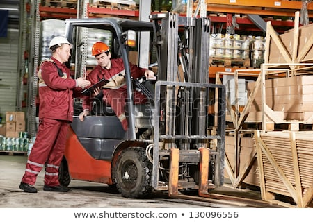 Two warehouse workers with forklift Stock photo © monkey_business