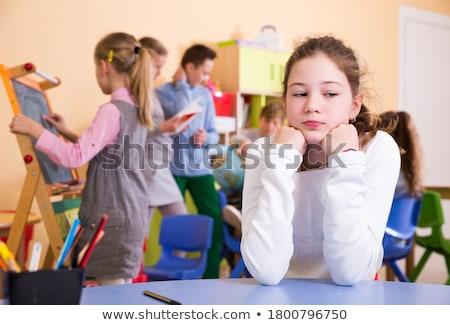 Сток-фото: школьница · сидят · первичный · класс · школы · счастливым